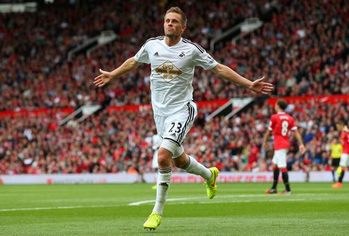 Gylfi Sigurdsson of Swansea City celebrates scoring his team's second goal as Manchester United crashed to an opening day defeat under their new manager. Photo credit: Alex Livesey/Getty Images