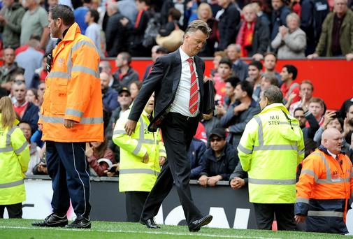 Manchester United manager Louis van Gaal leaves the pitch after his teams 2-1 defeat against Swansea City