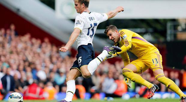 Tottenham Hotspur's Eric Dier shoots to score as West Ham United's Adrian looks on. Photo credit: REUTERS/Suzanne Plunkett
