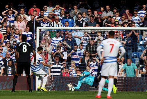 Queens Park Rangers' Charlie Austin (second left) watches as Hull City's goalkeeper Allan McGregor saves his penalty. Photo credit: John Walton/PA Wire.