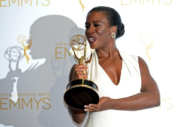 Actress Uzo Aduba poses backstage with the Emmy for Outstanding Guest Actress in a Comedy Series