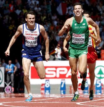 Third placed Chris O'Hare (L) crosses the finish line ahead Paul Robinson of Ireland (R) in the men's 1500 metres final during the European Athletics Championships at the Letzigrund Stadium in Zurich
