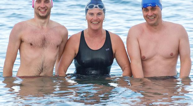 Pictured (from left) Stuart Moncreiff from Ballsbridge; Sandra Trappe from Dun Laoghaire; and Ceall O'Dunlaing from Phibsborogh, all members of the Dublin Swimming Club, at Killiney Beach in south Dublin. Photo: El Keegan