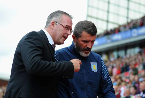 Aston Villa manager Paul Lambert talks to his assistant Roy Keane during their side's Premier League match against Stoke City at the Britannia Stadium. Photo: Chris Brunskill/Getty Images