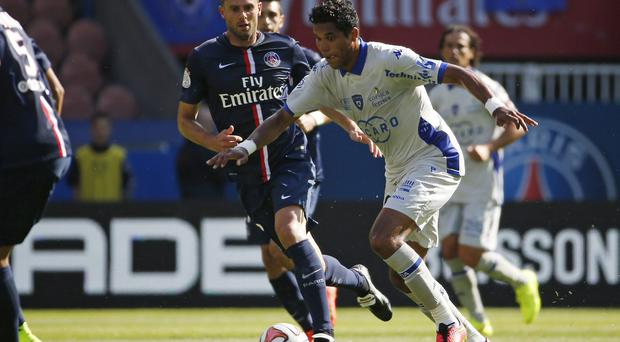 Bastia forward Brandao vies with Paris Saint-Germain's Thiago Motta during the French Ligue 1 game at the Parc des Princes in Paris. PSG were left fuming after Motta was left with a fractured nose following a bust-up in the tunnel at the end of the match. Photo: THOMAS SAMSON/AFP/Getty Images
