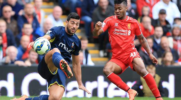 Southampton's Graziano Pelle (left) and Liverpool's Raheem Sterling battle for the ball