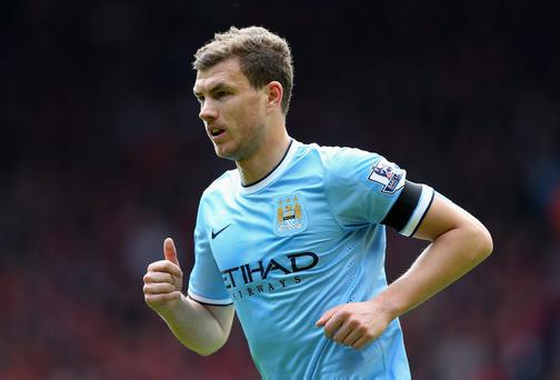 LIVERPOOL, ENGLAND - APRIL 13: Edin Dzeko of Manchester City in action during the Barclays Premier League match between Liverpool and Manchester City at Anfield on April 13, 2014 in Liverpool, England. (Photo by Alex Livesey/Getty Images)