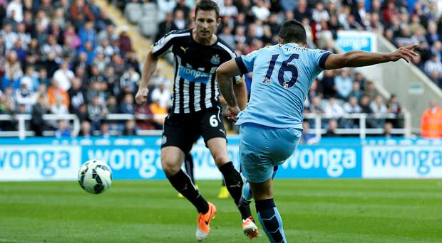 Manchester City's Sergio Aguero (R) scores a goal against Newcastle United