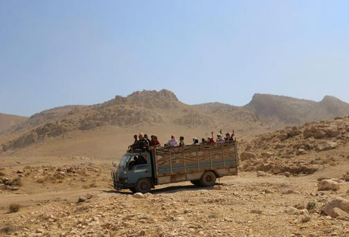Displaced people from the Yazidi religious minority are evacuated from Mount Sinjar in northern Iraq with the help of members of the Kurdish People's Protection Units. Photo: REUTERS/Rodi Said