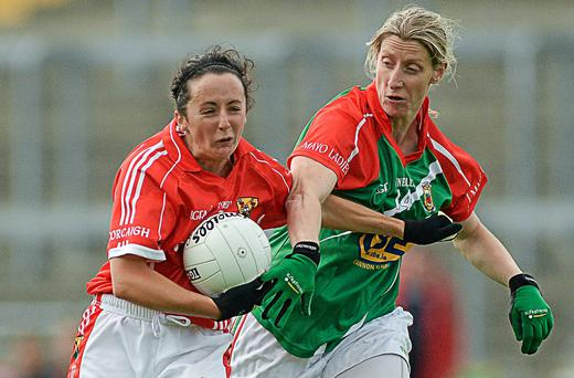 Geraldine O'Flynn, Cork, in action against Cora Staunton, Mayo. TG4 All-Ireland Ladies Football Senior Championship, Quarter-Final, Cork v Mayo, O'Connor Park, Tullamore, Co. Offaly (Piaras O Midheach / SPORTSFILE)