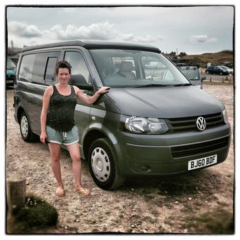 NEWQUAY, ENGLAND - AUGUST 08: Nicola Rousseau from Surrey poses for a photograph besides her 2010 fifth generation T5, Volkswagen Transporter van near Newquay on August 8, 2014 in Cornwall, England. The van, which was converted to a camper van this year is normally on hire through Nicola's company Littlefoot Campers. The Volkswagen Transporter was first produced in 1950 and has sold over ten million units worldwide evolving through five generations of functional and practical body styles, each representing the ultimate multi-purpose vehicle of its time. To commemorate the model's 60th anniversary in the UK Volkswagen has launched a special edition of the Transporter dubbed the Sportline 60. (Photo by Matt Cardy/Getty Images)