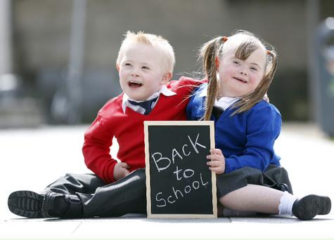Adam Cowzer and Amy Conroy, aged five, pictured at the launch of Marks & Spencer's partnership with Down Syndrome Ireland (DSI) for the back to school period. Down Syndrome Ireland collection boxes are situated at till points in selected M&S stores in the children's department until the end of August, raising money towards DSI's education programme
