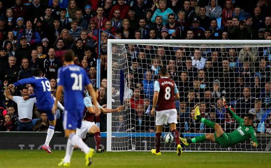 Chelsea's Diego Costa (L) scores past Burnley's Tom Heaton during their English Premier League soccer match at Turf Moor