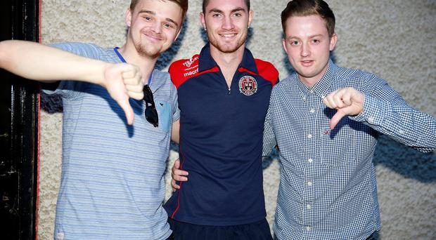 Bohemians player Eoin Wearen with fans Donal Breathnach and Liam Hoban who were left disappointed after referee Tomas Connolly called off the league clash between Bohemians and Shamrock Rovers due to damage to the pitch surface. Photo: Arthur Carron