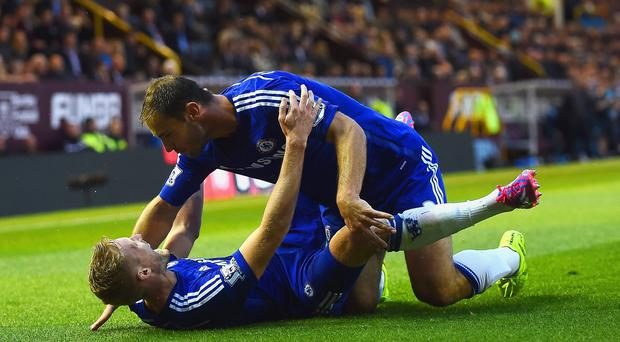 Andre Schurrle of Chelsea celebrates scoring their second goal with Branislav Ivanovic