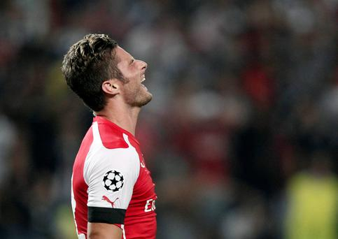 Arsenal's Oliver Grioud reacts during the first leg of their Champions League qualifying soccer match against Besiktas at Ataturk Olympic stadium in Istanbul