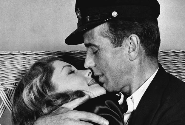 FILE - This 1944 file photo originally released by Warner Bros. shows actor Humphrey Bogart, right, holding actress Lauren Bacall in a scene from,