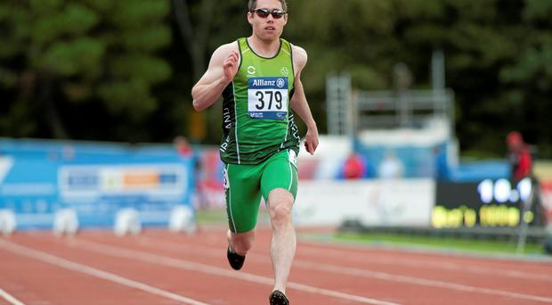 Jason Smyth sprints to gold in the the final of the men's 100m T12 at the IPC Athletics European Championships in Swansea. Photo: Luc Percival / SPORTSFILE