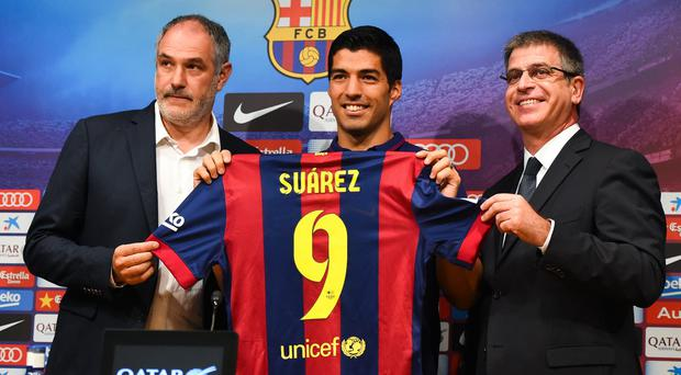Luis Suarez is unveiled as a Barcelona player by the club's sporting director Andoni Zubizarreta and executive vice-president Jordi Mestre at the Nou Camp. Photo: David Ramos/Getty Images