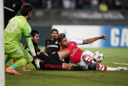 Olivier Giroud fails to find the target for Arsenal as Besiktas's Pedro Franco gets his toe to the ball during the Champions League play-off first leg match in Istanbul. Photo: AP Photo