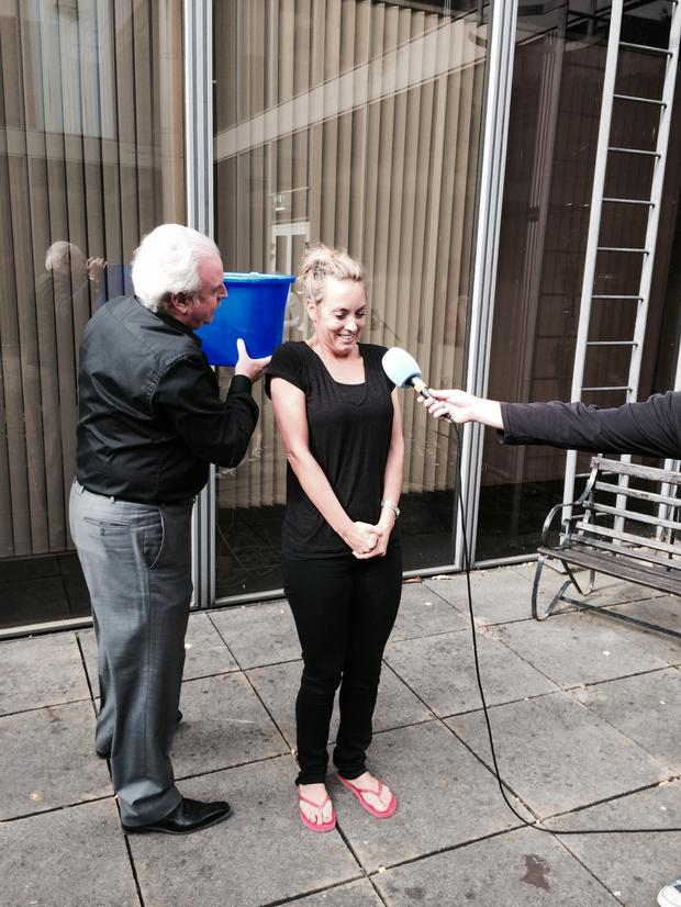 Kathryn Thomas taking the challenge with the help of Marty Whelan