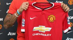 Marcos Rojo will wear the number five at Manchester United
