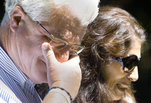 Parents Diane and John Foley talk to reporters after speaking with U.S. President Barack Obama. (AP Photo/Jim Cole)