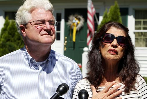 Diane and John Foley talk to reporters after speaking with U.S. President Barack Obama Wednesday, Aug. 20, 2014 outside their home in Rochester, N.H.