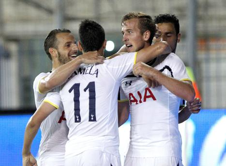 Harry Kane of Tottenham celebrates with his teammates his goal against AEL during their Europa League play-off first leg soccer match at Antonis Papadopoulos stadium in Larnaca