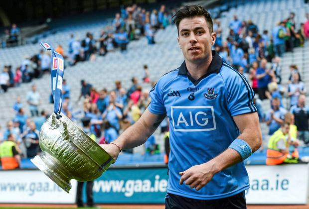 Dublin's Michael Darragh Macauley, celebrates with the Delaney cup after the Leinster Final. Picture credit: Piaras O Midheach / SPORTSFILE