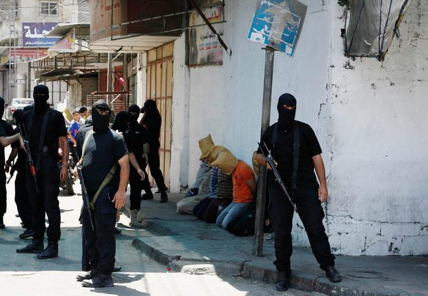 Hamas militants surround Palestinians suspected of collaborating with Israel