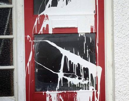 Damage caused after white paint was thrown at the front door of a house at Dunbeg Park in Hillsborough and a racist slogan placed on the door. Pic Colm Lenaghan