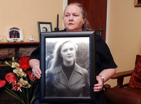 Josephine Pender with a photograph of her missing daughter, Fiona.