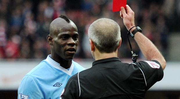 Mario Balotelli is sent off at Arsenal in 2012. Michael Regan/Getty Images