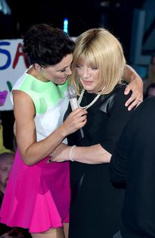Host Emma Willis (left) welcomes Kellie Maloney to the Celebrity Big Brother house at Elstree Studios, Borehamwood, at the start of the latest series of the Channel 5 programme. Photo: Ian West/PA Wire