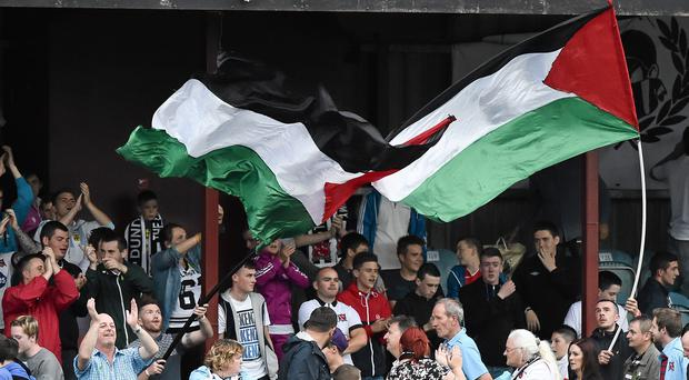 Dundalk supporters wave a Palestine flags against Athlone earlier this season