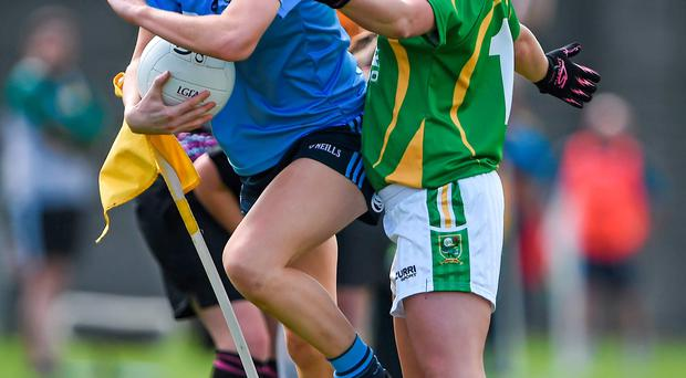 23 August 2014; Rachel Ruddy, Dublin, attempts to stay in play as she is put under pressure by Patrice Dennehy, Kerry. TG4 All-Ireland Ladies Football Senior Championship, Quarter-Final, Dublin v Kerry, St Brendan's Park, Birr, Co. Offaly. Picture credit: Brendan Moran / SPORTSFILE