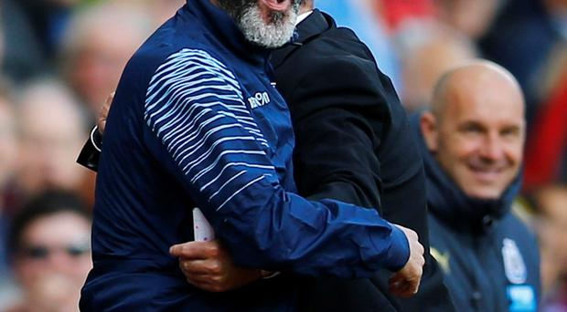 Aston Villa assistant manager Roy Keane hugs manager Paul Lambert (partially obscured) during their English Premier League soccer match against Newcastle United at Villa Park