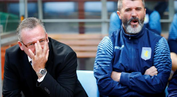Aston Villa manager Paul Lambert (L) and his assistant Roy Keane
