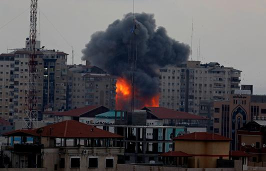 A ball of fire and smoke rise from an explosion on al-Zafer apartment tower following an Israeli air strike in Gaza City, in the northern Gaza Strip, collapsing the building, sending a huge fireball into the sky and wounding at least 22 people, including 11 children, witnesses and Palestinian officials said (AP Photo/Adel Hana)