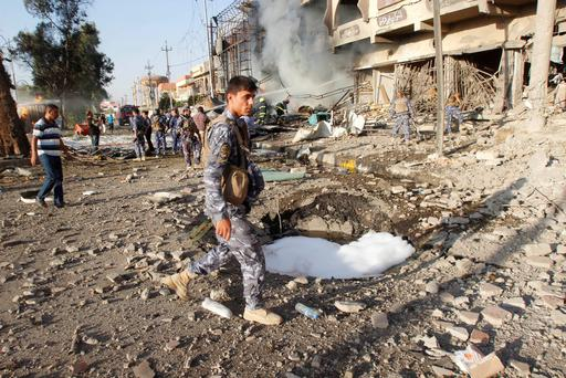 Kurdish security forces inspect the site of a car bomb attack in Kirkuk. Bombings across Iraq killed at least 35 people in attacks that appeared to be revenge for an assault on a Sunni mosque that has deepened sectarian conflict as the UN calls for action to prevent a possible 'massacre' on the northern Iraqi town of Amerli (REUTERS/Ako Rasheed)