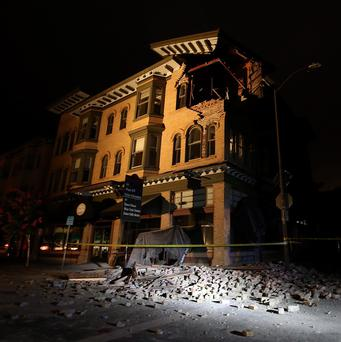 A building is seen destroyed following a reported 6.0 earthquake