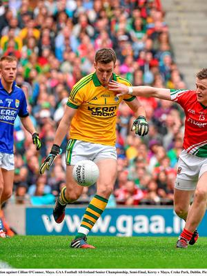 Brian Kelly, Kerry, in action against Cillian O'Connor, Mayo