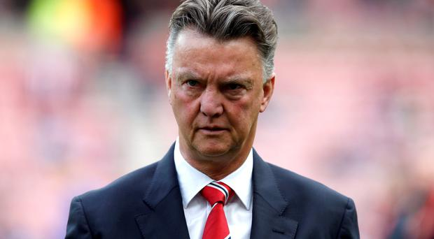 Manchester United manager Louis van Gaal leaves the pitch following their English Premier League soccer match against Sunderland