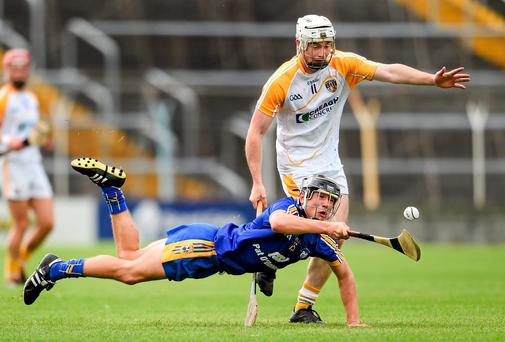 Gearóid O'Connell, Clare, in action against Stephen McAfee, Antrim