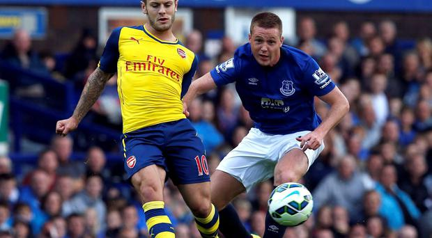 Everton's James McCarthy challenges Arsenal's Jack Wilshere
