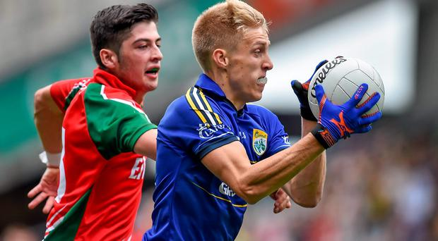 Killian Spillane, Kerry, in action against Séamus Cunniffe, Mayo