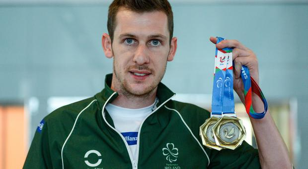 Team Ireland athlete Michael McKillop, from Newtownabbey, Co. Antrim pictured on his return at Dublin Airport from the 2014 IPC Athletics European Championships in Wales. Picture credit: Barry Cregg / SPORTSFILE