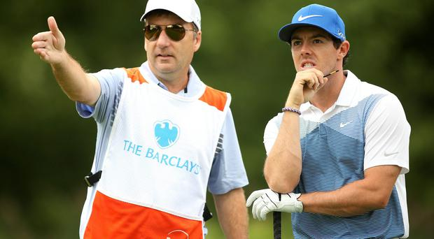 Rory McIlroy discusses his options with his caddie JP Fitzgerald during his final round at The Barclays in New Jersey. Photo: Darren Carroll/Getty Images