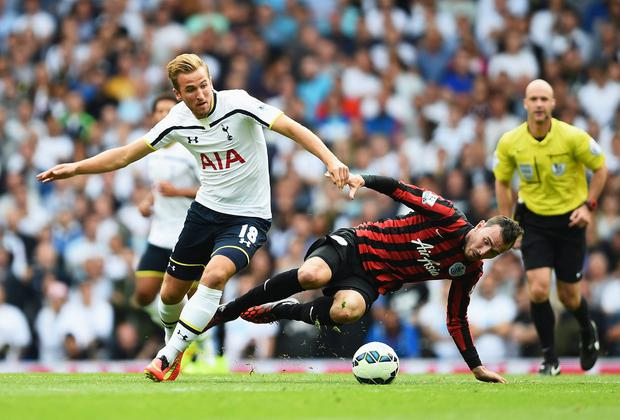 Spurs forward Harry Kane gets away from Jordon Mutch of QPR during the Premier League match at White Hart Lane. Photo: Jamie McDonald/Getty Images